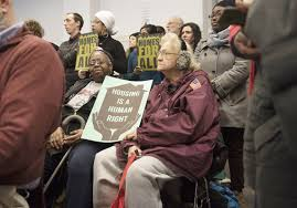 diana nelson jones walkabout affordability lost in penn community members hold signs while they attend a zoning and planning meeting for the penn plaza