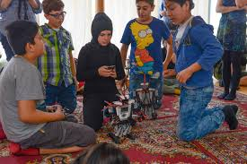 photo essay preparing refugee children for a digital future  muna 11 prepares her robot for testing the robots are part of a