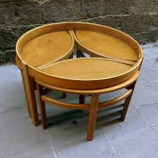 view larger round glass coffee table with matching nesting