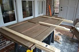 add braces to door headboard how to build a daybed from old doors thediybungalow