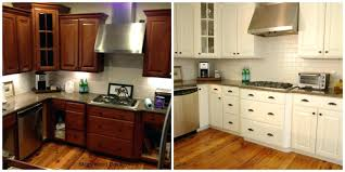 painted white kitchen cabinets before and after painting my oak kitchen cabinets white functionalities painting oak