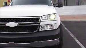 2006 silverado with morimoto Mini H1's and demon eyes - YouTube