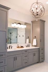 white bathroom cabinets with bronze hardware. grey master vanity with two towers, undermount sinks, antique bronze faucets and hardware, white bathroom cabinets hardware o