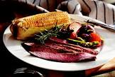bbq flank streak with roasted vegetables and corn