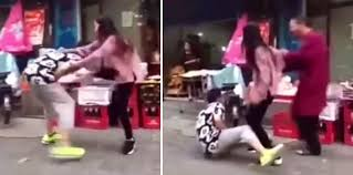 Asian girls kicking bare testicles