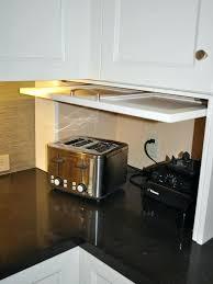 kitchen garage door hide your kitchen appliances with a garage style cabinet door kitchen window like