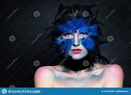 model face with bird makeup on dark background