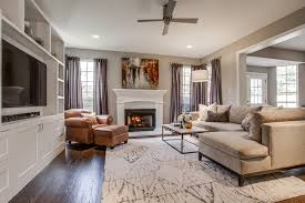 west elm area rugs living room transitional with transitional design dark wood floors