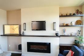 floating shelves above fireplace ideas