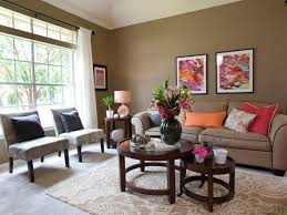 Nice Colors For Living Room This Lively Living Room Features An All Over Earthy Taupe Color
