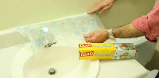 applying plastic wrap to vanity backsplash