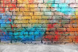 graffiti brick wall colorful background photo by ensuper