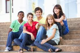 Group Of Teenage Friends Sitting On Stock Photo Colourbox