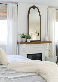 Master Bedroom Fireplace This Cozy Farmhouse Master Bedroom Features A Beautiful Diy