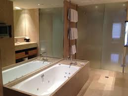 royce hotel spa bath with tv on bathroom wall