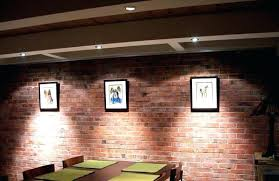 hanging things on brick walls without drilling amazing how to hang pictures on concrete walls hanging