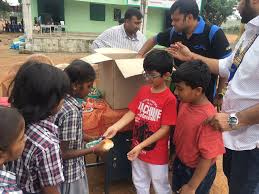round table india distribute food among 70000 underprivileged kids by ne reporter on