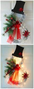 Let's Celebrate // Beautiful lighted grapevine snowman wreath to make for a Christmas  door decoration