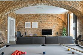 warm apartment with exposed brick walls designed by arhitektura ab objekt