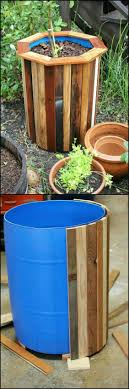 stylish and budget friendly diy planter box using plastic barrels covered in wood