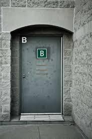 exterior metal doors. gray metal exterior door marked with the letter b doors d