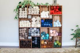 this yarn storage changed my life use wooden crates to build an easy shelf to
