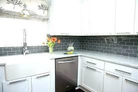 white kitchen cabinets with glass backsplash gray glass gray tile white kitchen cabinets with gray subway