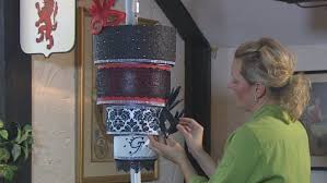 it takes several hours for yolande modica of top tier custom cakes to assemble and decorate the chandelier cake that s suspended using a steel rod going