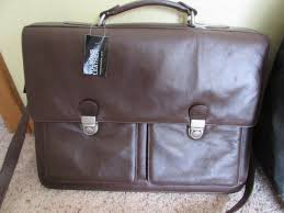 new wilson leather messenger bag and sports plus rolling pack