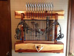bow hanger for wall introduction rack from reclaimed pallet wood compound