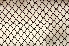 chain link fence texture. Background And Texture For Design. Abstract Chain Link Fence  Against Grungy Gray Color Wall E
