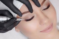 cosmetologist making permanent makeup close up tattooist making permanent make up attractive