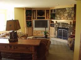 traditional family room designs. Corner Stone Fireplace And Built In Cabinet Using Excellent Paint Colors For Amazing Traditional Family Room Design Designs