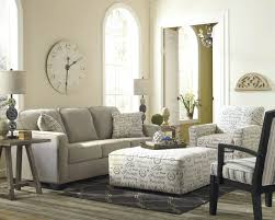 captivating living room design tufted. Light Toned Living Room Stands Over Grey Hardwood Flooring With Neutral Sofa Next Tocushion Ottoman Coffee Table Tufted Round Storage Images Captivating Design G