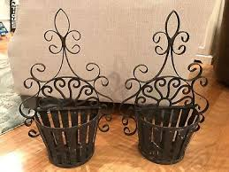 pair of wrought iron wall pocket