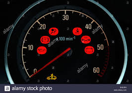 A British Car Dashboard Rev Counter Dial With Various Red Warning