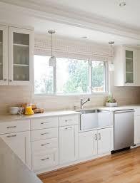 stainless steel farm sink in kitchen