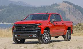 2019 Chevy Silverado: a red and black truck parked in front ...