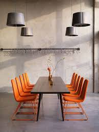 orange office furniture. game meeting chair in pure solid orange colour against dark wood and pale grey room surfaces officerooms furnitureoffice office furniture