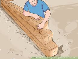 image titled build a strong retaining wall with 4x4 treated post step 11