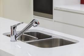undermount stainless steel sink in solid surface countertop