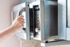 metal rack in microwave. Modren Rack Hand Opens Microwave Oven Door Intended Metal Rack In Microwave A