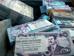 prosecutors seek to seize assets of i currency dealers times file in this dec 8 2003 file photo stacks of old i dinars portraying ousted leader saddam hussein lay in the port of basra
