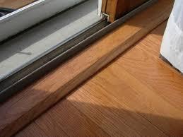 new floor trim along the sliding glass door
