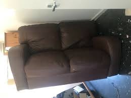 free 2 seater brown faux leather sofa paint damaged in norwich norfolk gumtree