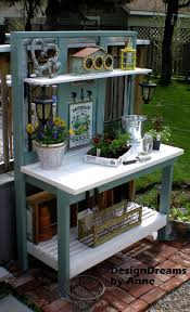 this is the potting bench i imagine when i think of someone s garden space i love the colors and the classic design of this bench