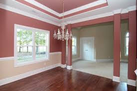 formal dining rooms with columns. columns in the formal dining room, with trey ceiling and two-tone paint. rooms h