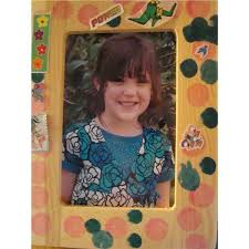craft s have many options for decorative picture frames the frame pictured here is decorated with dark and light colored washable bingo markers for
