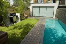 Lane swimming pool and contemporary garden designed and built by The Garden  Builders Fulham London SW6
