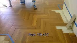 wood look tile flooring laid in herringbone pattern
